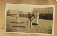 Photograph of students playing croquet on the Simmons College Campus yard