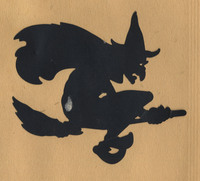 Black paper cutout of a witch on a broom