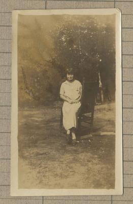 Photograph of woman sitting