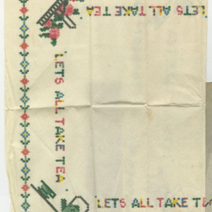 "Tea napkin decorated with faux-needlepoint designs, including a floral garland around the border, tea service and flower baskets. Transcription: ""Let's All Take Tea"". Unfolded: 36 by 36 cm"