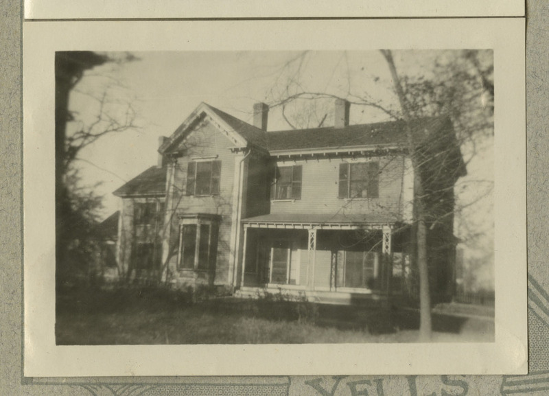 Black and white photograph of a house and yard